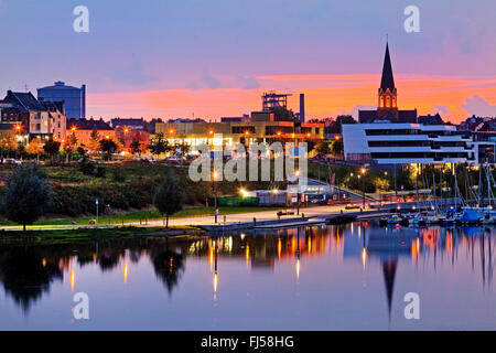 Lake Phoenix with blast furnace and steeple in the evening, Germany, North Rhine-Westphalia, Ruhr Area, Dortmund - Stock Photo