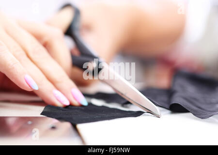 Tailor. Tailoring . Hands notch tailor tailor's scissors cloth - Stock Photo
