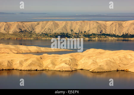 view from Velebit mountain range to the Adriatic Sea with Pag island in morning light, Croatia, Pag - Stock Photo
