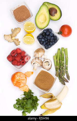 An assortment of healthy, fresh foods on a white background. - Stock Photo