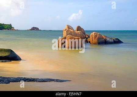 granite rocks in the Indian Ocean early in the morning, Seychelles, Praslin, Grand Anse - Stock Photo