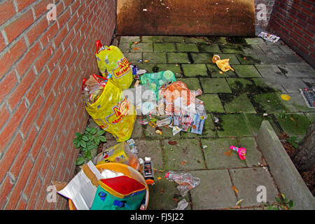 plastic bags full of waste between to houses, Germany