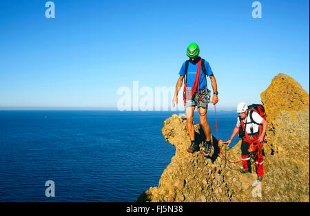 two climbers on the top of the Bec de l'Aigle mountain, France, Provence, Calanques National Park, La Ciotat - Stock Photo