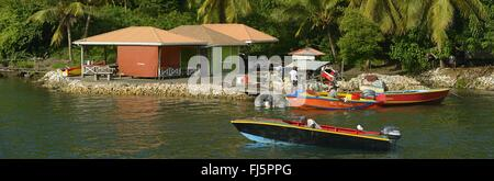 Fisher men in the Prickly bay near the town of Saint Georges on the island of Grenada, Grenada, Sandy island, Saint - Stock Photo