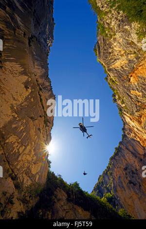 rescue helicopter over the narrow canyon of Verdon, France, Provence, Verdon - Stock Photo