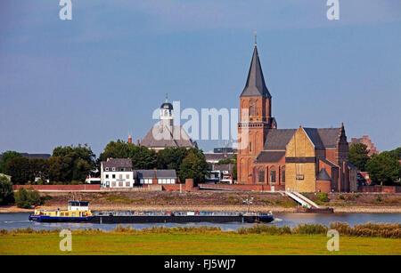 transport ship on Rhine, Christuskirche and Martinikirche of Emmerich in background, Germany, North Rhine-Westphalia, - Stock Photo