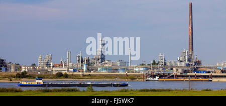 two transport ships on the Rhine, chemical plant Johnson Matthey Chemicals in background, Germany, North Rhine-Westphalia, - Stock Photo