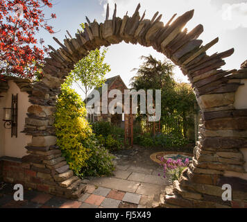 Moongate made from stone, stone paving and brick structure building,  Alchemy gardens permanent show garden Malvern - Stock Photo