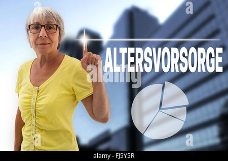 pension provision in german altersvorsorge touchscreen is shown by senior. - Stock Photo