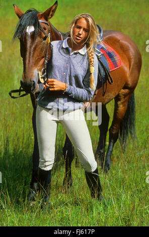 Young woman and horse, France - Stock Photo