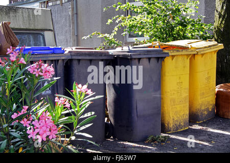 different trashbins for residual waste and recycling bins, Germany - Stock Photo
