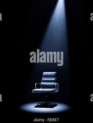 Mastermind-style Eames 219 chair under spotlight. - Stock Photo