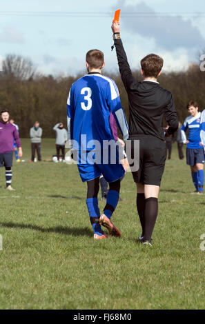 Sunday League football, referee sending off player, showing the red card - Stock Photo