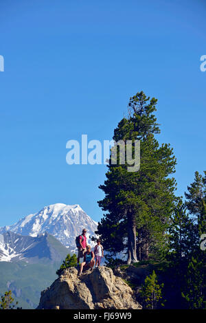 Family during a trek in Les Arcs Bourg saint Maurice, France, Savoie - Stock Photo