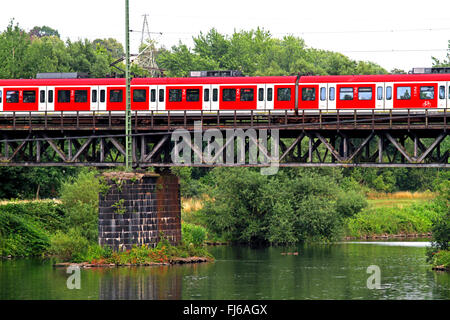 S-Bahn city train crossing the Ruhr river, Germany, North Rhine-Westphalia - Stock Photo