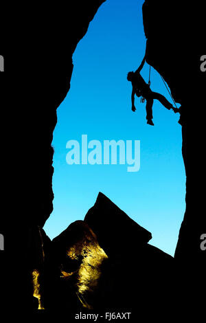 woman climbing the rocks, a hard route in Savoie, silhouette, France, Savoie - Stock Photo