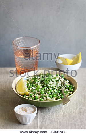 Couscous salad with peas and fresh mint - Stock Photo