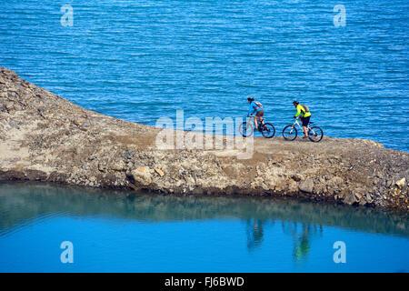 Mountain biking around Alp lake Lac du Mont Cenis, France, Savoie - Stock Photo