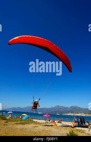 paraglider landing on the beach of Saint Florent, France, Corsica, Saint Florent - Stock Photo