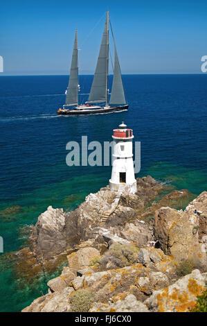 Porto Cervo,Arzachena,Sardinia,Italy, 29/05/2015.Sailing yacht along the Capo Ferro lighthouse, during an Emerald - Stock Photo