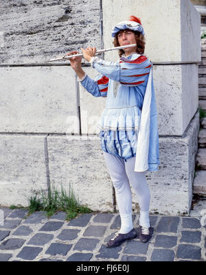 Flute player in period costume on street, Szentendre, Pest County, Central Hungary Region, Republic of Hungary - Stock Photo