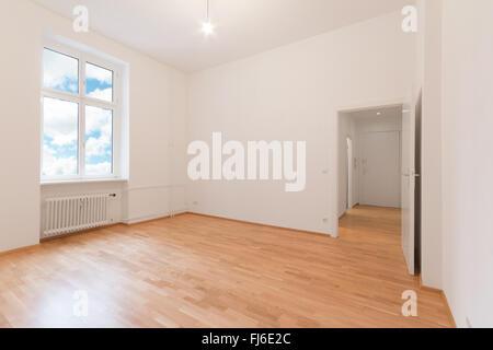 renovated flat - empty room, white walls wooden floor - Stock Photo