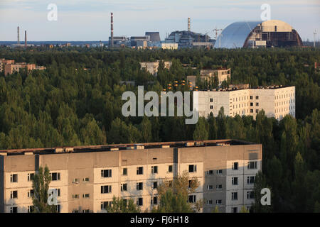 Aerial view of Pripyat and the nearby Chernobyl nuclear power plant with the New Safe Confinement. Zone of Alienation, - Stock Photo