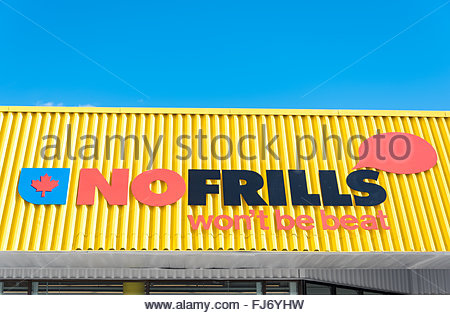 Newly redesigned Nofrills sign. No Frills is a chain of deep discount supermarkets in Canada, owned by Loblaw Companies - Stock Photo