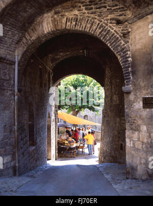 Small street market, Assisi, Province of Perugia, Umbria, Italy - Stock Photo
