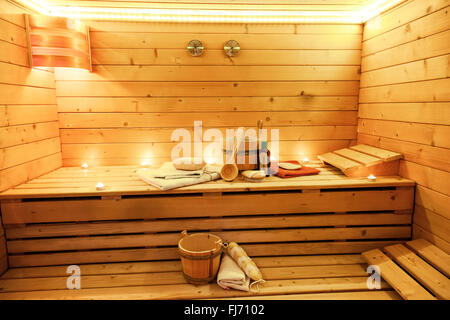 Sauna room with traditional sauna accessories - Stock Photo