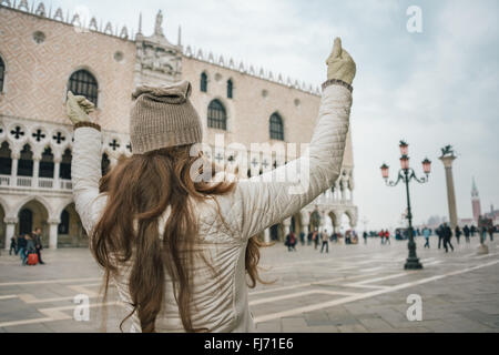Delightful Venice, Italy can help make the most of your next winter getaway. Seen from behind young woman tourist - Stock Photo