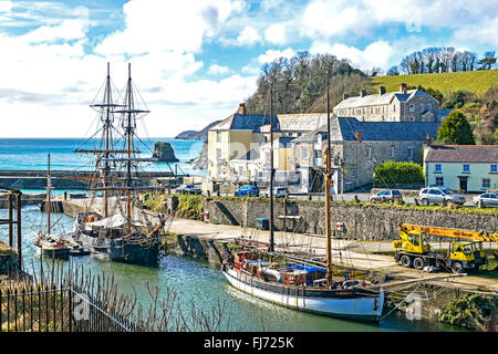 Tall ships in the historic port at Charlestown, Cornwall, England, UK - Stock Photo