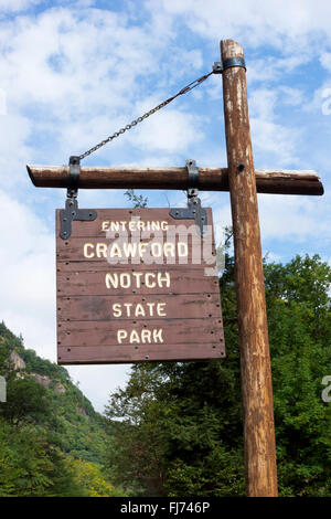 Wooden roadside sign  at an entrance to Crawford Notch State Park, in Carroll County, New Hampshire, USA - Stock Photo