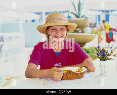 Young girl eating pasta in restaurant, Forte Dei Marmi, Province of Lucca, Tuscany Region, Italy - Stock Photo