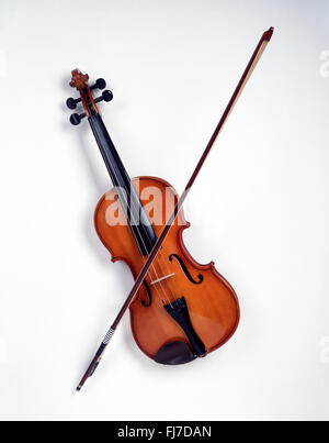 Still-life of violin with bow on white background, London, England, United Kingdom