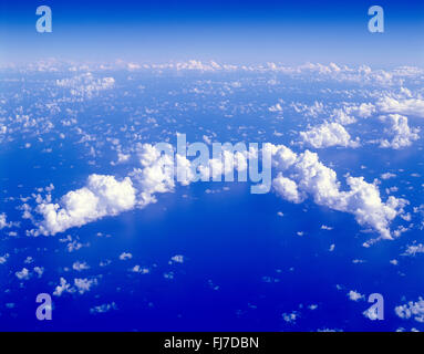 Aerial view of clouds from aircraft over sea - Stock Photo
