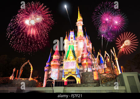 Display of fireworks and colorful lights on Cinderella's Castle in Magic Kingdom at DisneyWorld, Orlando, Florida - Stock Photo