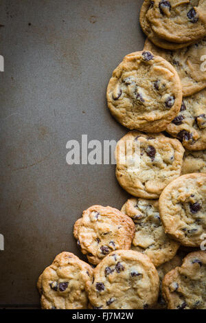 batch of homemade chocolate cookies on baking sheet with copy space - Stock Photo