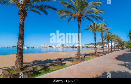 Mid morning sun on Ibiza waterfront.  Warm sunny day along the beach in St Antoni de Portmany Balearic Islands, - Stock Photo