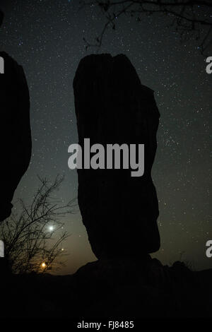 The Milky Way and stars over the silhouette of the Balancing Rock in Chillagoe. - Stock Photo