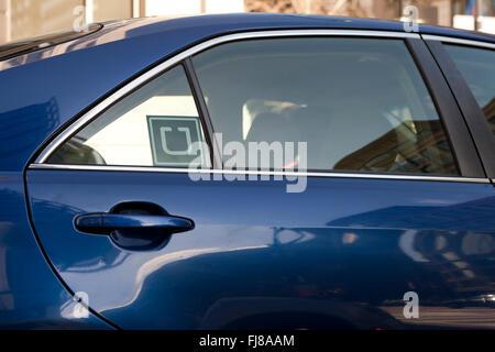 Uber sticker on car window - USA - Stock Photo