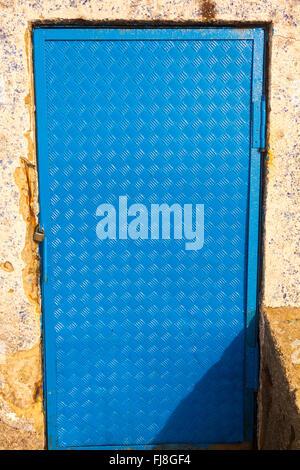 Sheet metal door in blue - Stock Photo