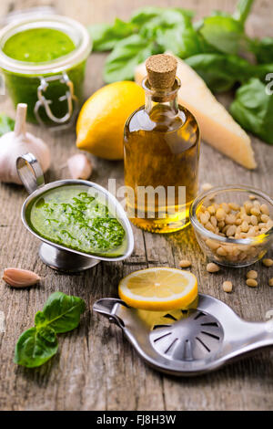 Composition with ingredients for sauce pesto preparing on rough - Stock Photo