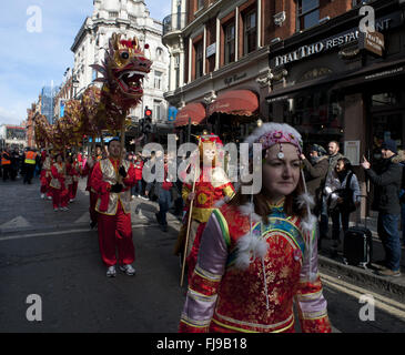LONDON UK Performers carry a traditional dragon during celebrations marking the Chinese New Year here 14 February - Stock Photo