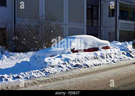 car buried in snow, Finland - Stock Photo