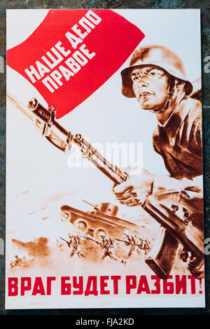 Soviet russian patriotic propaganda poster from World War II with image of soldier going on attack with rifle. - Stock Photo