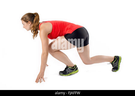 Young athletic sports woman sprint start in profile. Isolated on white background. - Stock Photo