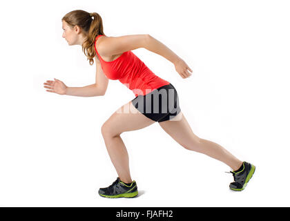 Young athletic sports woman running in profile. Isolated on white background. - Stock Photo
