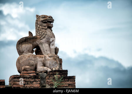 BAGAN, MYANMAR--A restored statue of a dragon on top of an elephant on the roof of Abeyadana Temple. Located just - Stock Photo