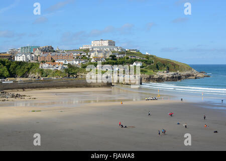 View across Fistral beach to harbour in Newquay, Cornwall, England. With people on beach - Stock Photo